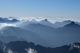 Fog from Fansipan Summit in Sapa Vietnam Photographic Print by  khlongwangchao