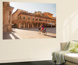 Woman Cycling Through Piazza Del Popolo, Ascoli Piceno, Le Marche, Italy Wall Mural by Ian Trower
