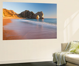 Waves Sweeping onto the Deserted Beach at Durdle Door, Dorset, England. Winter Wall Mural by Adam Burton