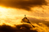 Christ the Redeemer Statue in Clouds on Sunset Print by  dabldy