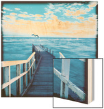 Pier and Dolphins Wood Print by Colin Anderson