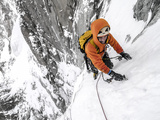 Tom Grant Arriving in the Upper Couloir Nord Des Drus, Chamonix, France Photographic Print by Ben Tibbetts