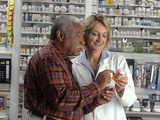 Man Consults with Pharmacist Photographic Print by Stocktrek Images