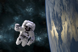 An Astronaut Floating Above Earth Photographic Print by Stocktrek Images