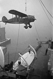 Aircraft Gets Transported on a Ship Photographic Print by Hanns Tschira