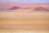 Africa, Namibia. Heat Distorts Grassy Plain and Red Sand Dunes Photographic Print by Jaynes Gallery