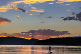 Standup Paddleboarder Silhouetted by Sunset, Whitefish Lake, Montana Photographic Print by Chuck Haney