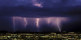 Lightning Discharges from Storm Cloud over City. Tucson, Arizona Photographic Print by Thomas Wiewandt