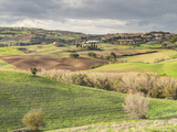 Italy, Tuscany. Landscape and the Town of San Quirico Dorcia Photographic Print by Julie Eggers