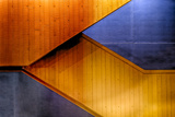 Graphic Composition of Orange Stairs Against a Blue Wall Photographic Print by Rona Schwarz