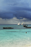 Tanzania, Zanzibar, Nungwi, Traditional Sailing Boat with Storm Photographic Print by Anthony Asael