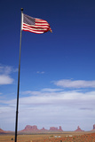 USA, Navajo Nation, Monument Valley, American Flag and Rock Formations Photographic Print by David Wall