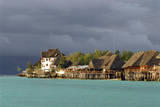 Tanzania, Zanzibar, Nungwi, Tourist Resort on Stilts Photographic Print by Anthony Asael