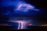 Sunset Rain and Lightning Storm, Plains of San Agustin, New Mexico Photographic Print by Thomas Wiewandt
