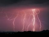 Two Minute Exposure of a Lightning Storm. Marana, Arizona Photographic Print by Thomas Wiewandt