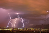 Sunset Lightning Storm in the City. Tucson, Arizona Photographic Print by Thomas Wiewandt