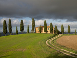 Italy, Tuscany, Pienza. Tuscan Farmhouse with Stormy Clouds Photographic Print by Julie Eggers