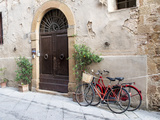 Italy, Tuscany, Pienza. Bicycles Parked Along the Streets of Pienza Fotografisk tryk af Julie Eggers