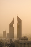 Sunset Engulfs the Jumeirah Emirates Towers Hotel Dubai, Uae Photographic Print by Michael DeFreitas