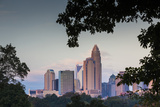 North Carolina, Charlotte, Elevated View of the City Skyline at Dusk Photographic Print by Walter Bibikow