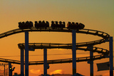 Los Angeles, Santa Monica, Roller Coaster at Sunset, Pacific Park Photographic Print by David Wall