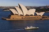 Australia, Sydney, Circular Quay, Sydney Opera House at Dusk Photographic Print by Walter Bibikow