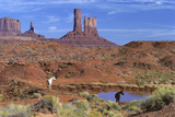 Two Horses at a Water Hole in Monument Valley. Navajo Tribal Park Photographic Print by Thomas Wiewandt