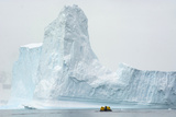 Antarctica. Charlotte Bay. Zodiac Dwarfed by a Giant Towering Iceberg Photographic Print by Inger Hogstrom