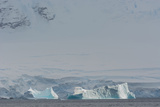Antarctica. Gerlache Strait. Iceberg with Glacier in the Background Photographic Print by Inger Hogstrom