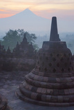 Borobudur, Java, Indonesia. Stupa and Mount Merapi at Sunrise Photographic Print by Charles Cecil