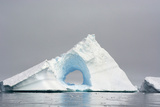 Antarctica. Charlotte Bay. Giant Iceberg with a Hole Photographic Print by Inger Hogstrom