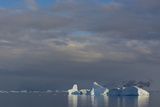 Antarctica. Gerlache Strait. Iceberg and Cloudy Skies Photographic Print by Inger Hogstrom
