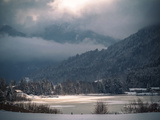 Light in the Winter Storm over Frozen Lake Photographic Print by Sheila Haddad