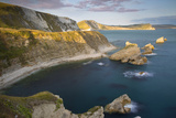 Sunset over Mupe Bay Along the Jurassic Coast, Dorset, England Photographic Print by Brian Jannsen