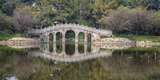 Chinese Bridge over Green Lake in Kunming, China Photographic Print by Darrell Gulin
