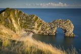 Sunset over Durdle Door Along the Jurassic Coast, Dorset, England Fotografie-Druck von Brian Jannsen
