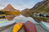 Boats on Calm Morning at Two Medicine Lake in Glacier National Park, Montana, USA Photographic Print by Chuck Haney