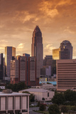 North Carolina, Charlotte, Ty Skyline from the Southeast, Sunset Photographic Print by Walter Bibikow