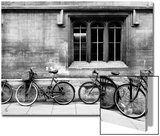 A Row of Bikes Leaning Against an Old School Building in Oxford, England Prints by Keith Barraclough