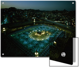 Thousands of pilgrims circle the Kaaba in illuminated view at night Prints by Thomas J. Abercrombie