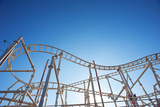 Roller-Coaster with Blue Sky. Photographic Print by  pio3