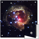 Radiation from a stellar burst ricochets off dust particles Prints by Esa And Nasa