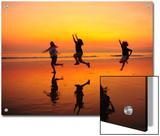 Silhouetted Children Playing on the Beach at Sunset Prints by Jorge Fajl