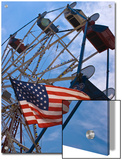 Flag in Front of a Ferris Wheel Against a Summer Sky, New London, Connecticut, USA Print by Todd Gipstein