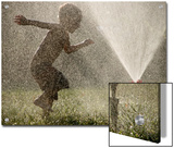 A Boy Plays in a Sprinkler on a Hot Summer Day Posters by Heather Perry