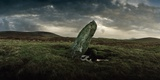 A Megalithic Standing Stone with Standing Rainwater in its Depressed Area Photographic Print by Macduff Everton