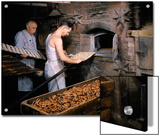 Men Load Trays of Pretzels into a Bakery's Old-Fashioned Oven Posters by Howell Walker