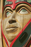 Close Up of a Face on a Traditional Haida Totem Carving in Ketchikan, Alaska Reproduction photographique par  Design Pics Inc