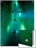 In Stargate Blue Hole, Divers Illuminate North Passage Art by Wes C. Skiles