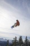 Man Snowboarding, Jumping in Mid-Air; Vancouver Island Ranges, British Columbia, Canada Reproduction photographique par  Design Pics Inc